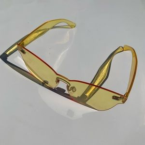 Clear, yellow tinted glasses